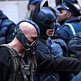 Christian Bale as Batman and Tom Hardy as Bane on the set of The Dark Knight Rises.