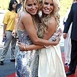 Carmen Electra and Jessica Simpson hugged on the red carpet at the Teen Choice Awards in August 2006.