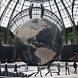 Models walked around a giant globe for Fall 2013.
