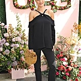 Rosie attended the Ugg Spring 2017 campaign launch toting a Cult Gaia basket bag. She chose simple separates and espadrille wedges to round out the seasonal look.