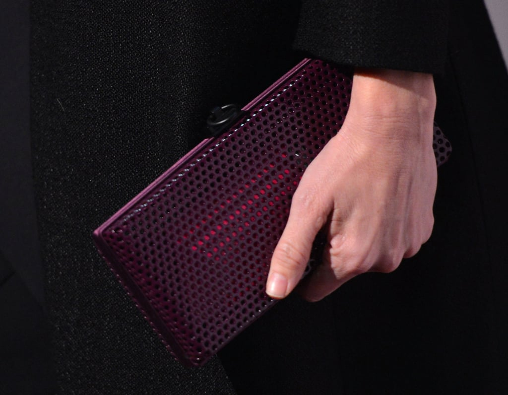 A perforated clutch added a modern element to Naomi's party ensemble.