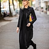 Wear leggings or tight-fitting skinny jeans that you can tuck into boots underneath the chiffon maxi you style with swimsuits in the Summer. Finish with a hat and a luxe-looking jacket.