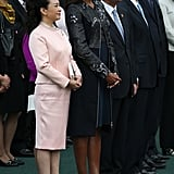 She Looked Extremely Sophisticated in Baby Pink Next to Michelle Obama