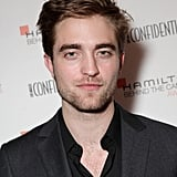 Robert Pattinson stifled a smile for the camera.