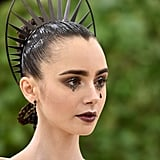 Lily Collins's Dark Art Inspiration at the Met Gala