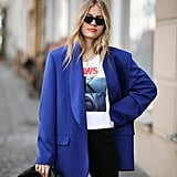 Dress up your favourite tee with biker shorts and a cool blazer.