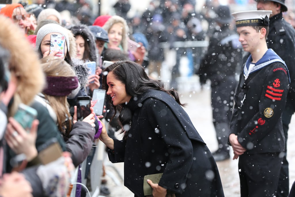 "It looks like Meghan Markle is taking a page out of Princess Diana's handbook. While members of the royal family, like Queen Elizabeth II, have been known to wear gloves while shaking hands at events, Meghan recently decided to go against royal protocol during a recent appearance in Bristol, England, on Friday. Despite the frigid temperatures (it was literally snowing, you guys), Meghan opted not to wear gloves as she shook hands with people in the crowd.  Following her appearance, people couldn't help but draw comparisons to Princess Diana, who also opted not to wear gloves when greeting people. ""She abandoned the royal protocol of wearing gloves because she liked to hold hands when visiting people or shake hands and have direct contact,"" Eleri Lynn, the curator of an exhibit on Princess Diana's style, previously told People about the late royal. In fact, part of the reason Diana stopped wearing wide-brimmed hats was because it made it harder to greet and hug her young admirers.  This certainly isn't the first time Meghan has paid tribute to her mother-in-law. In addition to wearing some of Diana's jewellery, she has also dressed like the royal from time to time.       Related:                                                                                                           Watch Out, 2019: Meghan Markle Is Just Getting Started"