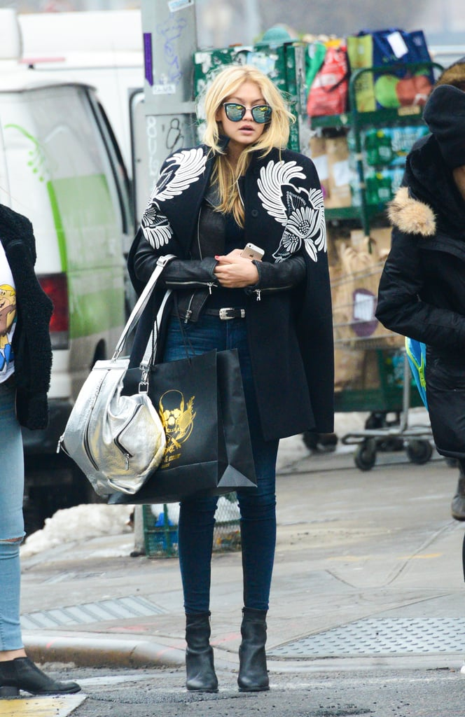 Gigi hit the streets in an embroidered cape and mirrored shades in February 2015.