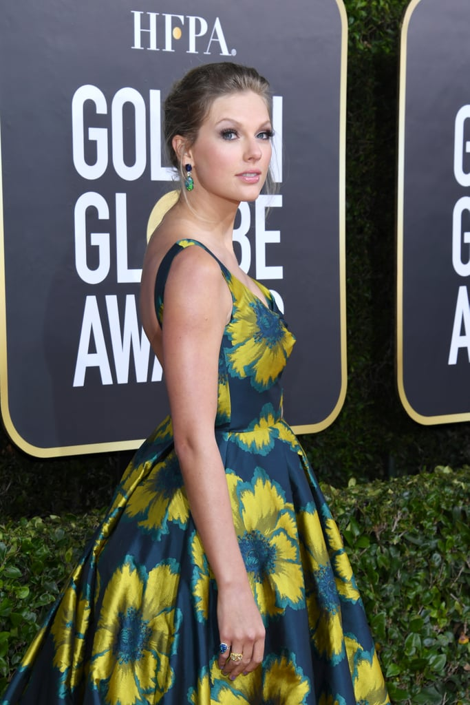 "Taylor Swift looked absolutely gorgeous as she attended the Golden Globes on Sunday. The singer, who is nominated for best original song for writing ""Beautiful Ghosts"" in Cats, stepped out on the red carpet wearing a green floral print gown. As if her stunning appearance wasn't enough to get excited about, she also made a rare appearance with boyfriend Joe Alwyn, whose film Harriet is up for two awards. Though the two didn't pose together, they were spotted chatting with award show goers as they arrived at their table. Hopefully, we'll get some rare couple moments during the show.       Related:                                                                                                           The Tiny Glimpses We've Gotten of Taylor Swift and Joe Alwyn's Love Story"