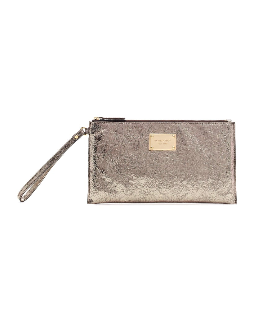 Give your outfit a quick flash of metallics with this Michael Michael Kors Large Jet Set Crinkled Clutch Bag ($88).