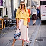 Styling a yellow pair with a button-down top and matching skirt.
