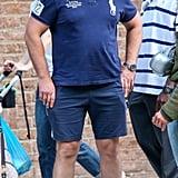 Russell Crowe wore shorts and a blue polo.