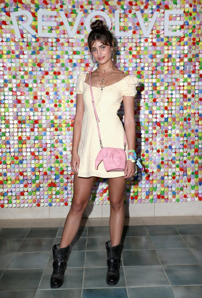 Taylor Hill wore a yellow LPA dress and boots at #REVOLVEfestival.