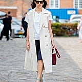 Layer a longer coat or vest over your shorts for a look that plays with proportions in the most elegant way.
