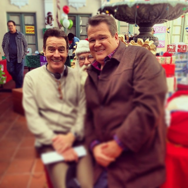 Bryan Cranston and Eric Stonestreet got a head start on the holidays when they sat on Santa's lap together. Source: Instagram user ericstonestreet