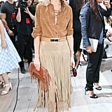 Never one to shy away from fringe, Olivia kept her colour palette neutral but paired her textured bag with a suede two-tiered skirt.