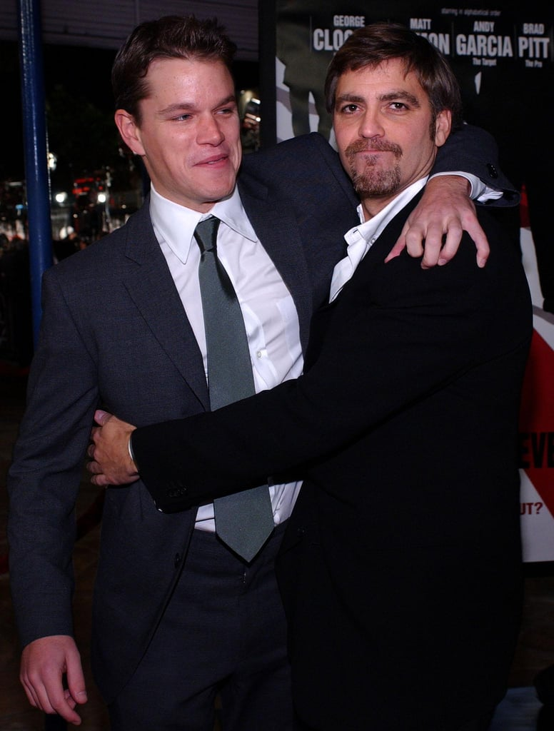 George Clooney grabbed onto Matt Damon at the premiere of Ocean's Eleven in December 2001.