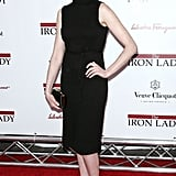 Anne Hathaway slicked her hair back in a chignon for a premiere.