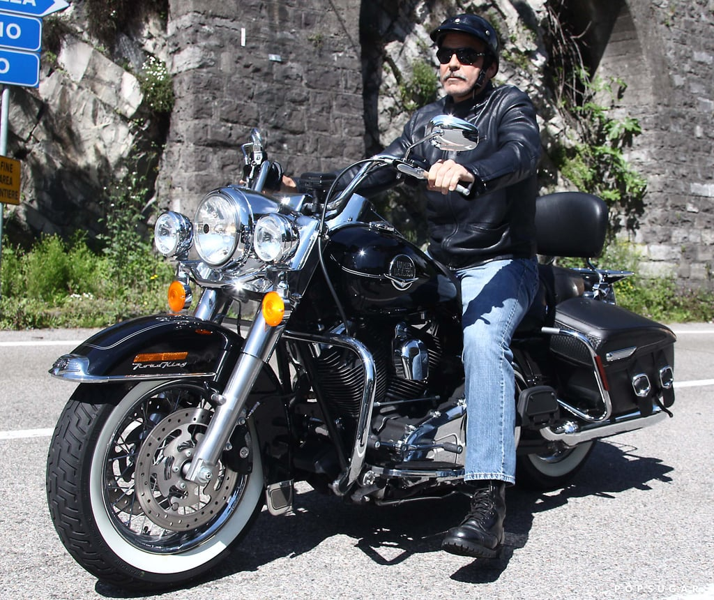 George Clooney rode a motorcycle in Como, Italy.