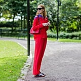 A Red Suit Is Intriguing, Yes, but Even More So With Birkenstocks in Place of Heels