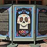 Outside a Coco exhibit, you can learn more about Día de los Muertos.