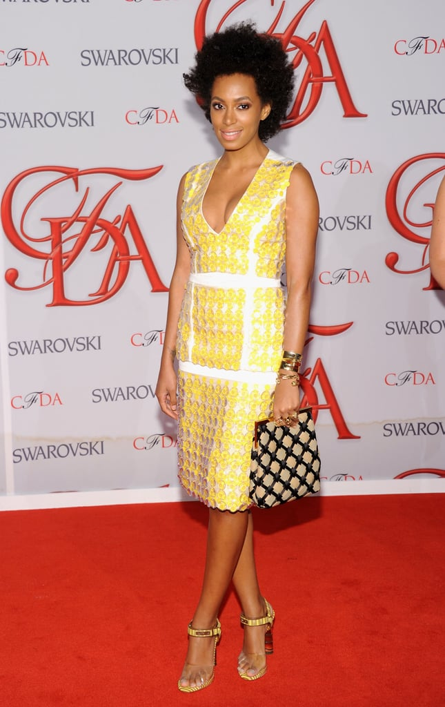For the 2012 CFDA Fashion Fund Awards, Knowles mixed prints in a white-and-yellow Marni sheath and lucite-detailed Missoni sandals.
