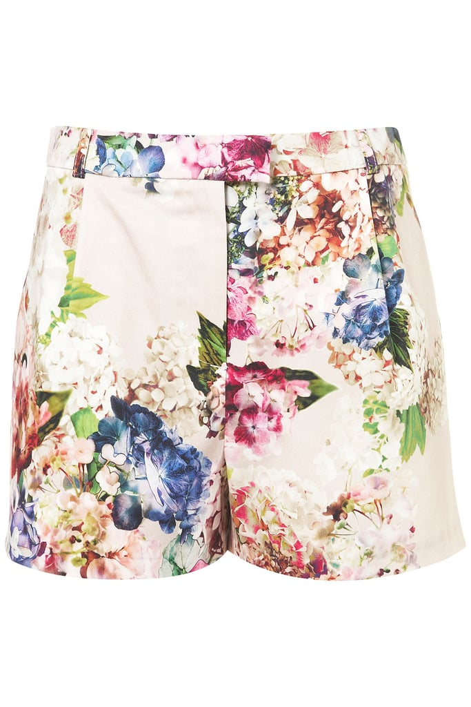 Tuck a plain cotton V-neck into these pretty floral cotton shorts and call it a (sweltering) day. Topshop Co-Ord Floral Print Shorts ($70)