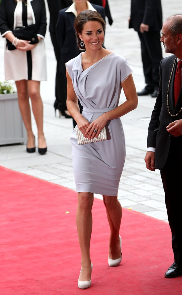 Kate Middleton attended the UK's Creative Industries Reception at the Royal Academy of Arts in London this evening to celebrate over 800 Britons who participate in the arts. She dressed for the event in a gray Roksanda Ilincic dress she also wore during her time in the US last Summer. At the gala, however, Kate's hair was up, showing off her earrings. The gala came after a busy day at the Olympics. Kate supported Zara Phillips during Zara's equestrian competition, along with other royals like Prince William, Princess Beatrice, and Princess Eugenie. William added another sporting event to his itinerary. William and Harry watched the artistic gymnastics men's team final, and cheered on Team Great Britain to a win. This evening, Kate mingled with UK prime minister David Cameron and Royal Academy of Arts president Christopher Le Brun. They were treated to a performance from singer Tyler James inside the event.