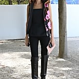 Taylor Tomasi Hill was street-style perfection in a black peplum top and statement vest.