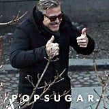 George Clooney gave a thumbs-up on the set of The Monuments Men in Berlin.