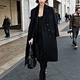 While strutting down the streets of NYC, Karlie Kloss wore head-to-toe black and accessorized with a Christian Dior bag and strappy sandals.