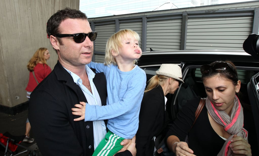 Liev Schreiber carried Sasha, who made a funny face.