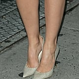 In a move to spice up her sweet, lacy look, she wore nude snakeskin Jimmy Choo pumps.