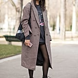 Style Them With Sheer Tights, a Checkered Coat, and an Oversize Tee