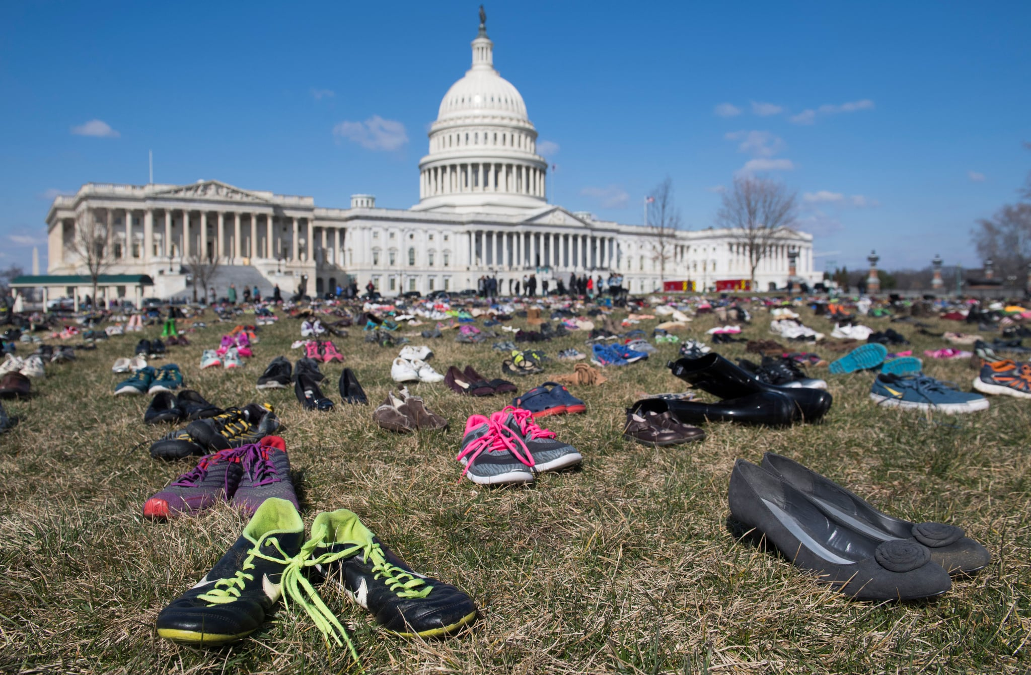 The lawn outside the US Capitol is covered with 7,000 pairs of empty shoes to memorialize the 7,000 children killed by gun violence since the Sandy Hook school shooting, in a display organised by the global advocacy group Avaaz, in Washington, DC, March 13, 2018. / AFP PHOTO / SAUL LOEB        (Photo credit should read SAUL LOEB/AFP/Getty Images)
