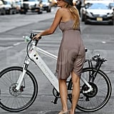 Blake Lively on  a white bike.
