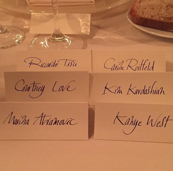 "Givenchy designer Ricardo Tisci shared a snap of the place cards, writing, ""The real family dinner @courtneylove @carineroitfeld @hudsonmai @kimkardashian #celebration #love #gang."""
