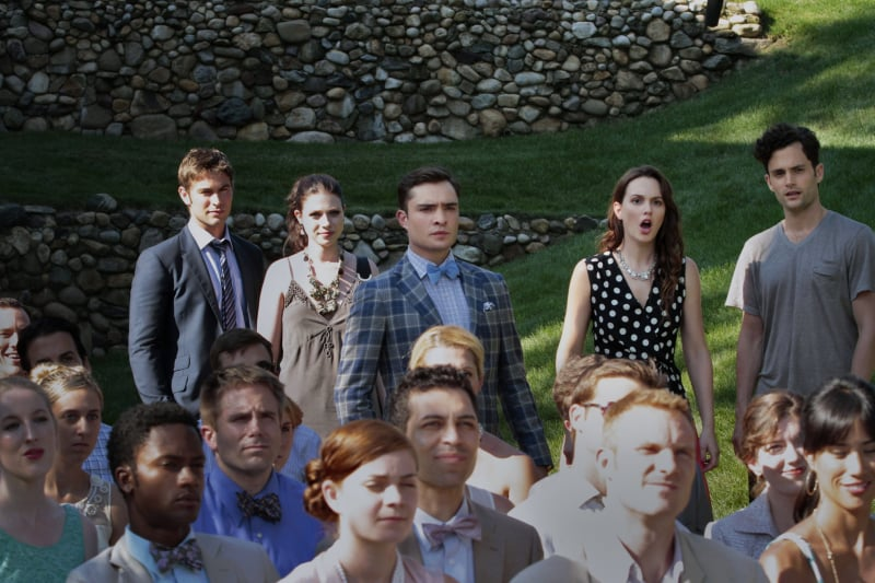 The gang looks on at what appears to be a wedding. Blair looks particularly outraged.