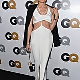 Diane Kruger, at the GQ Men of the Year party, showed off her style prowess in a white cutout Cushnie et Ochs dress, Vanessa Bruno blazer, and strappy Jimmy Choo sandals.