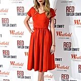 Taylor Swift matched her bright red lips to her pretty fiery-red fit-and-flare dress in London.