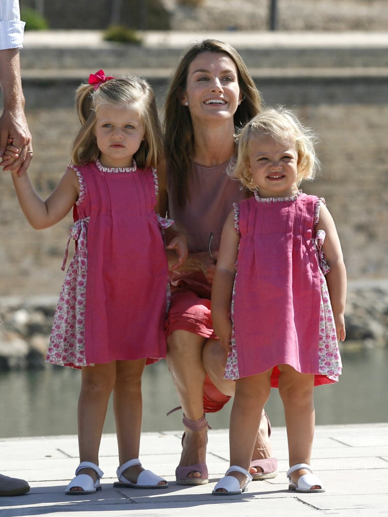 Princess Letizia of Spain posed with her two daughters during a family walk in August 2009.