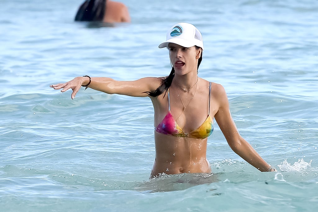 Alessandra splashed around in the ocean near her hotel.