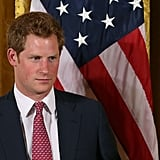 Prince Harry looked amazing standing next to an American flag.