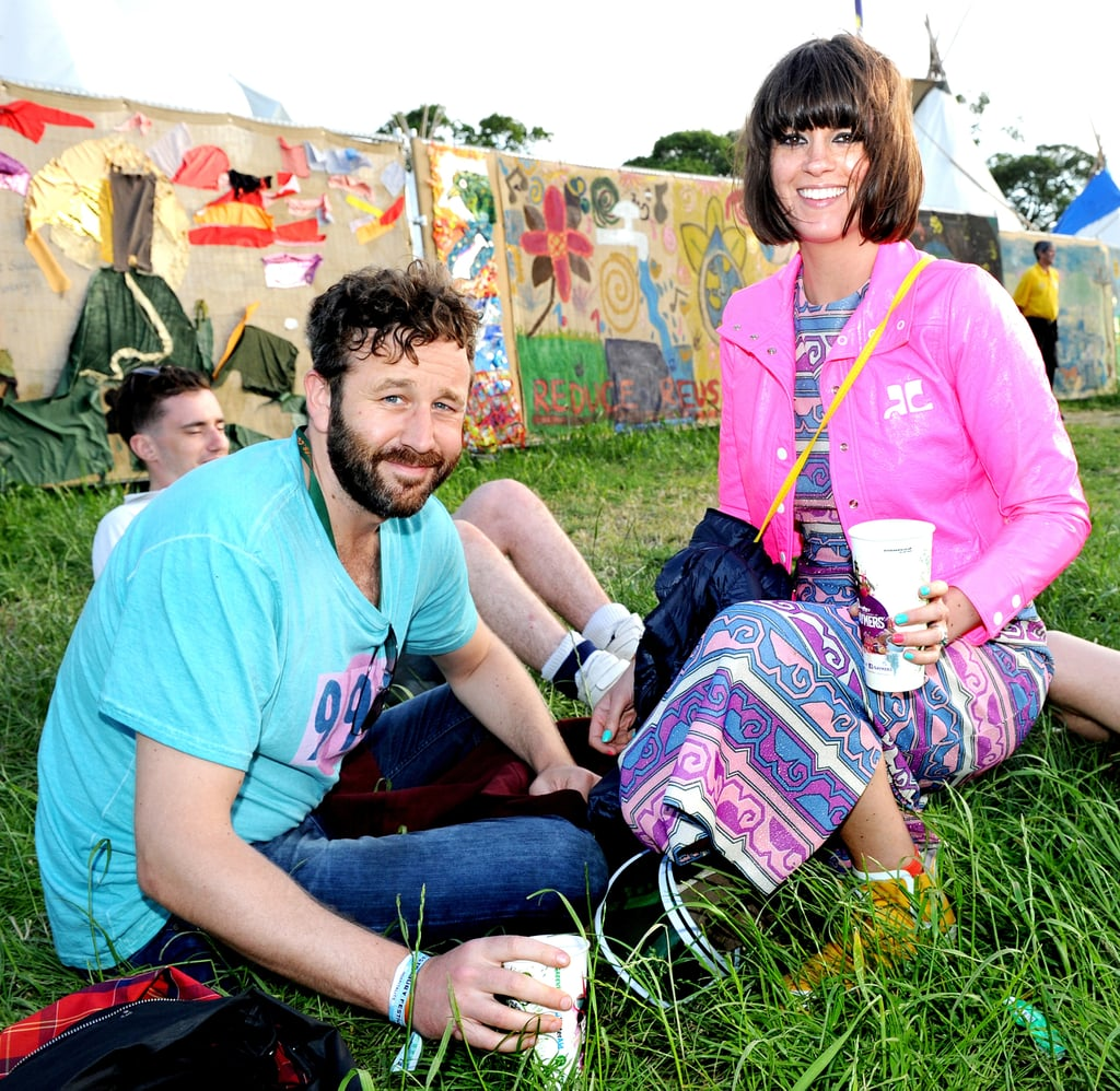 Chris O'Dowd and his wife, Dawn Porter, relaxed on the grass.