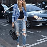 Gigi styled boyfriend jeans and trainers with a statement jacket — and statement shades to match.