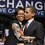 Barack plants one on Michelle during an Indiana campaign event.