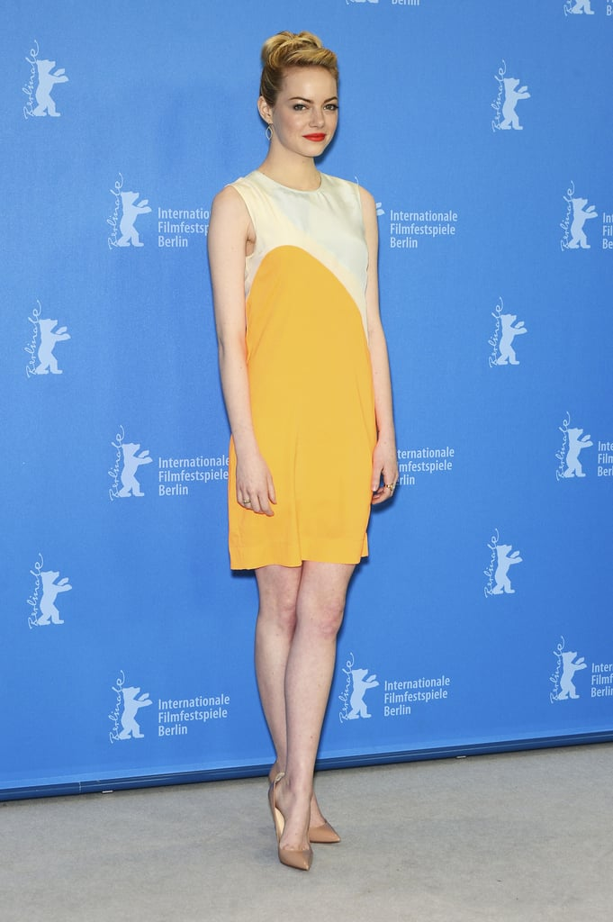 Emma Stone punched up her style in a colour-blocked mustard Stella McCartney dress at The Croods photocall in Berlin.
