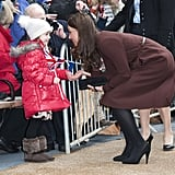 Kate bent down to greet a little girl during a solo trip to the Alder Hey Children's Hospital in Liverpool, England, back in February 2012.