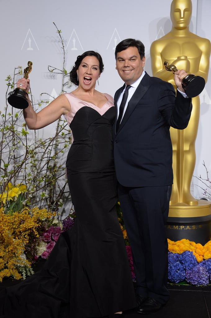 """EGOT winner Robert Lopez and his wife, Kristen Anderson-Lopez, were adorable after accepting their best original song award for """"Let It Go"""" from Frozen."""