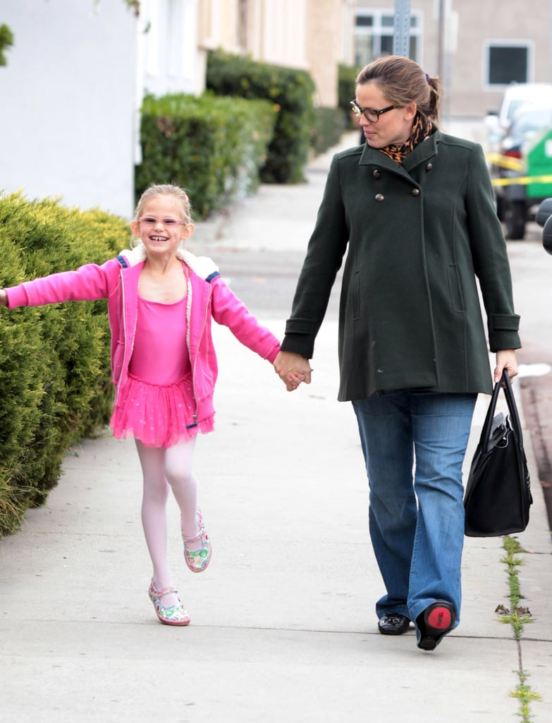 Violet's hoodie matched her bright pink ballet uniform.
